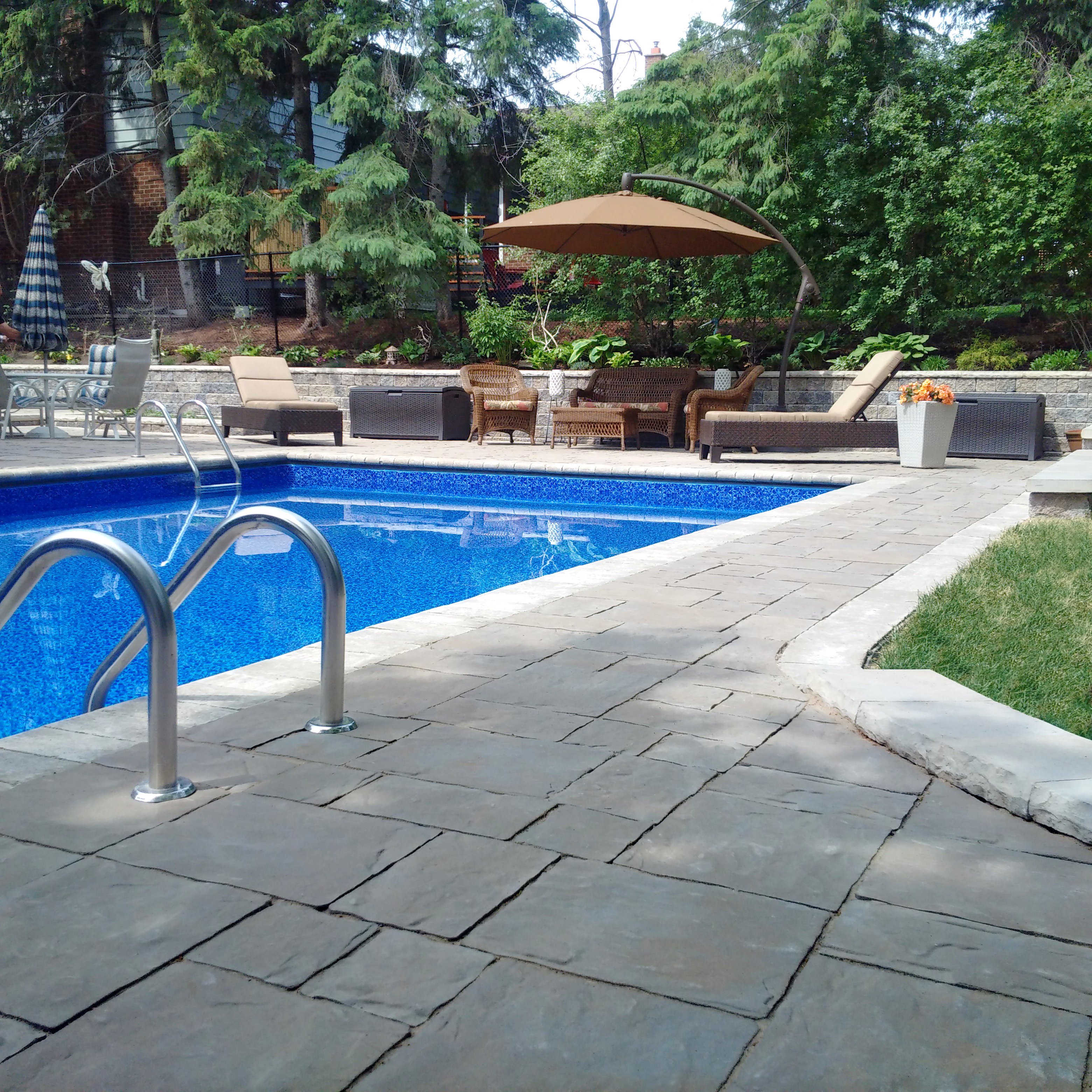 Creating the perfect pool patio area unilock Flagstone pavers around pool