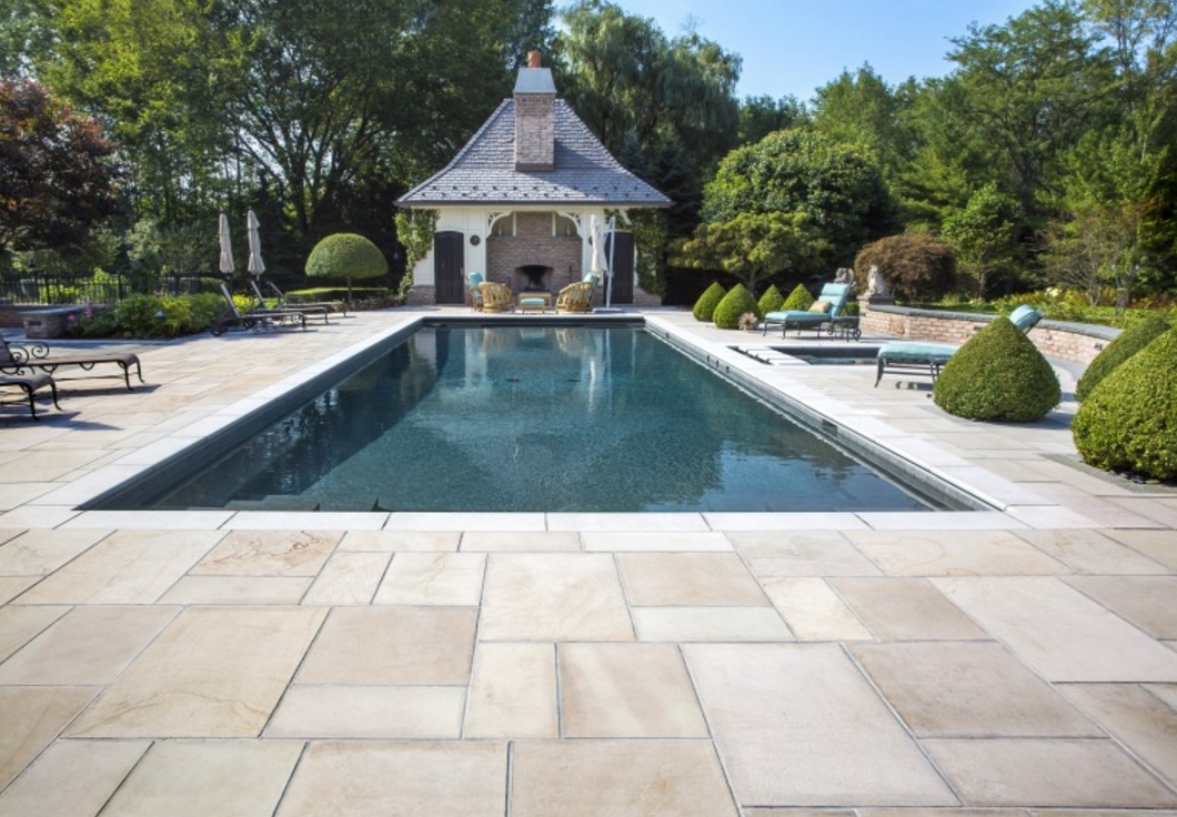 Natural stone by unilock vs traditionally sourced for Natural stone around pool