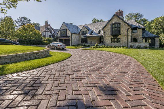 Tips for maintaining a paved glen cove ny driveway unilock for Temperature to pour concrete driveway