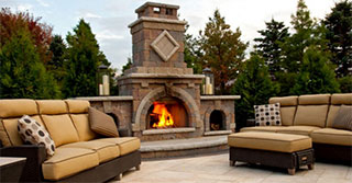 Add Warmth and Beauty to your Landscaping with an Outdoor Fireplace