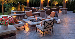 Mix it up! Concrete Pavers and Walls, Natural Stone, and Wood Decking Come Together