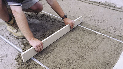 Screeding Concrete pavers - Stone pavers -hardscaping - NY, NJ, PA, CT