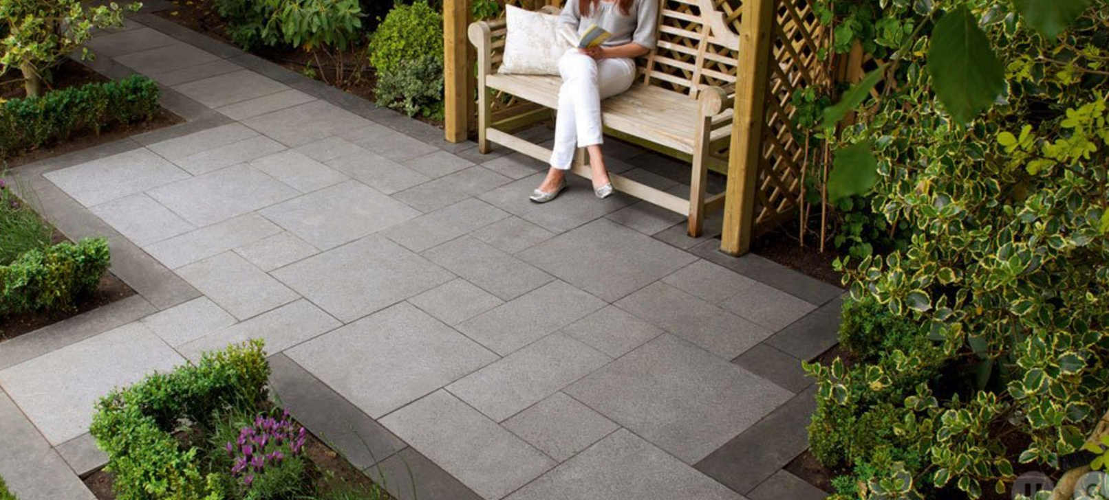 adding natural stone or concrete pavers to your outdoor spaces
