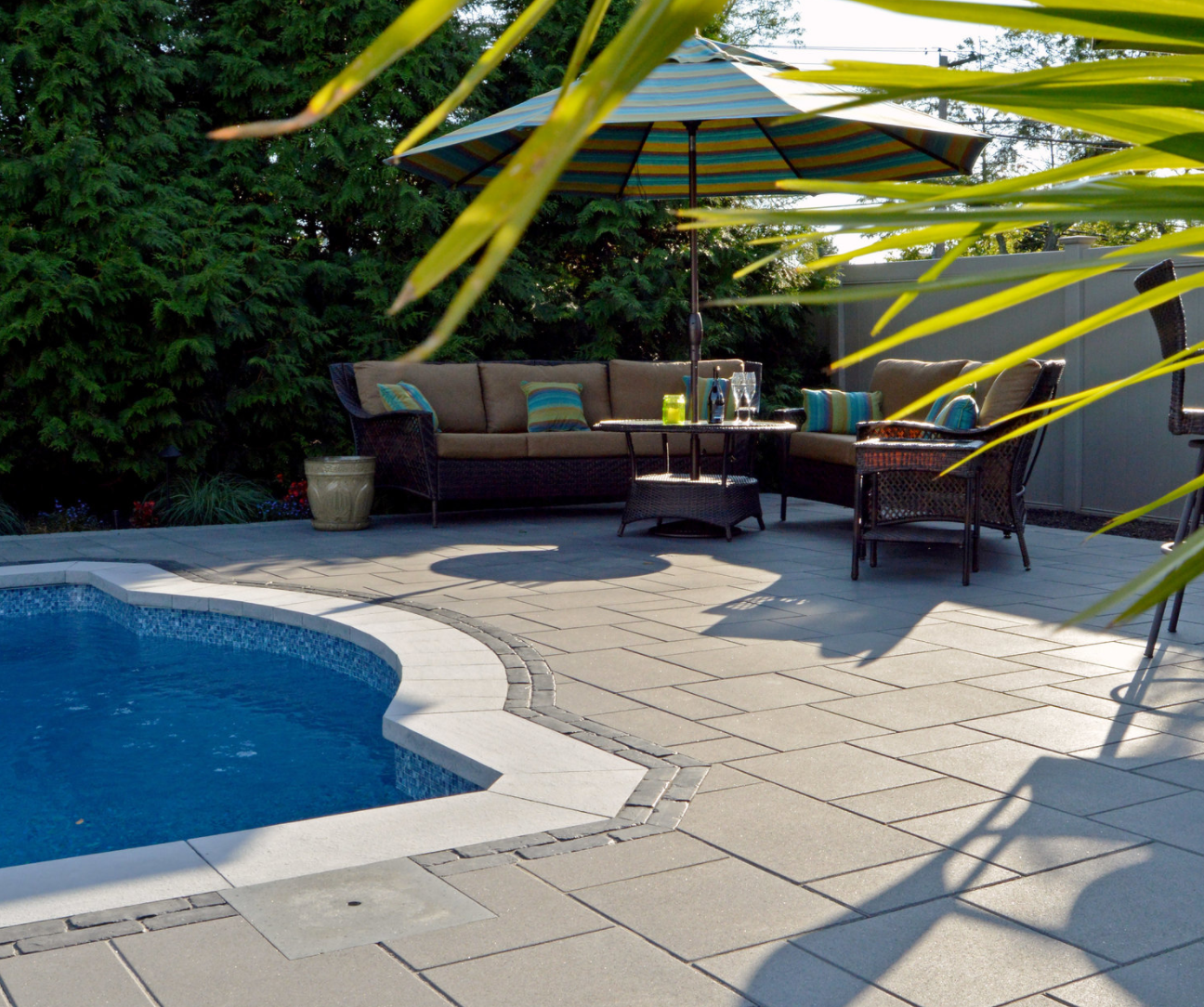 a poolside oasis in long island ny features unilock u0027s umbriano