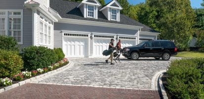 Unilock driveway, with exposed agregate Tribeca Cobble pavers and Copthorne accent
