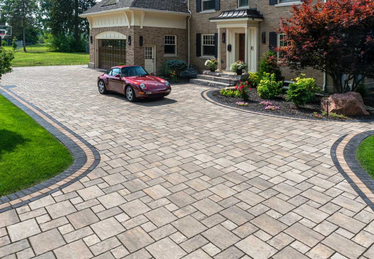 Unilock driveway, walkway and entrance using flagstone-textured Thornbury EnduraColor pavers