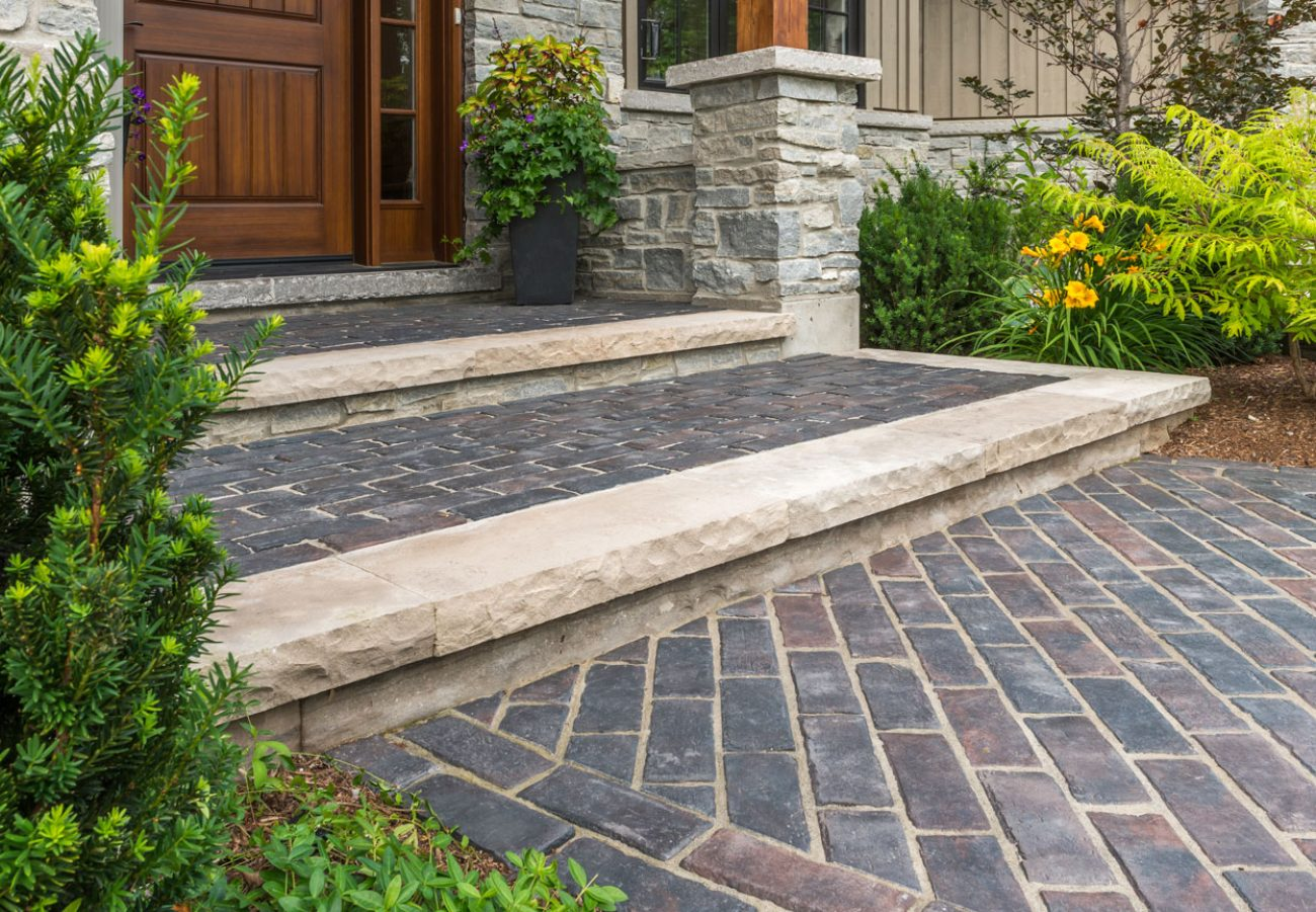 Heritage-inspired entryway with Unilock Town Hall Elegance pavers