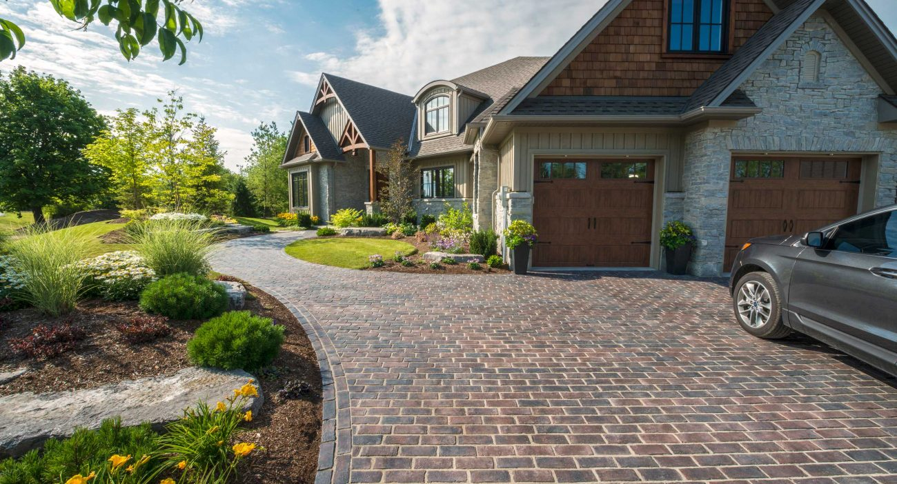 Heritage-inspired driveway and entryway with Unilock Town Hall Elegance pavers