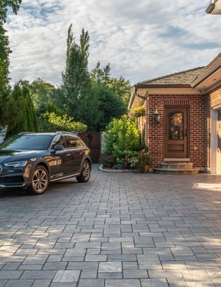 Unilock flagstone-textured driveway, with Richcliff Elegance pavers