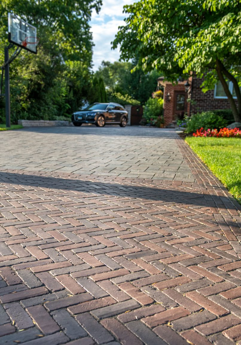 Unilock flagstone-textured driveway, with Richcliff and Copthorne Elegance pavers