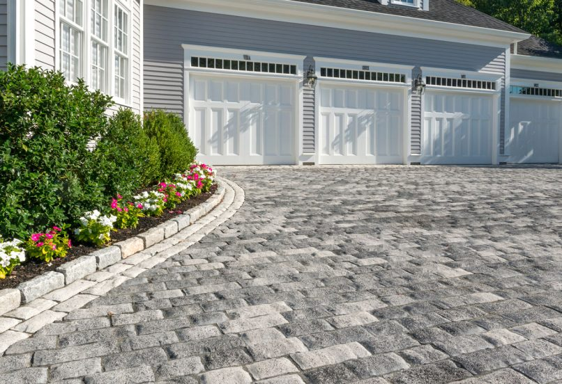 Unilock driveway, with exposed agregate Tribeca Cobble pavers