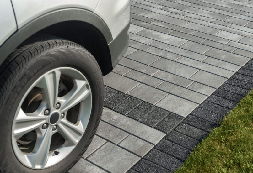 Contemporary Unilock Artline linear plank paver driveway, with granite-like Series border