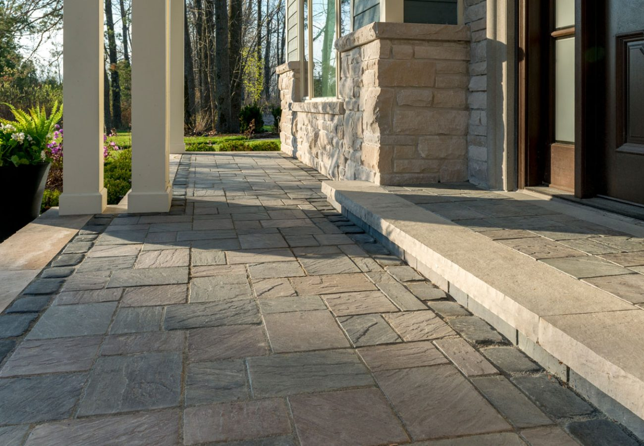 Unilock flagstone-textured entrance and walkway using Richcliff Elegance pavers and Courtstone border