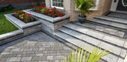 Contemporary Unilock entrance with Artline plank pavers, Ledgestone steps, and Lineo Dimensional Stone garden wall