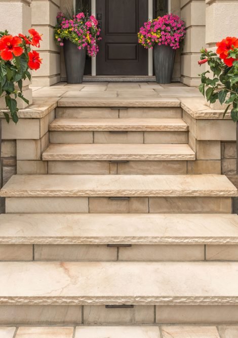 Unilock entrance with Natural Stone flagstone pavers and Ledgestone steps