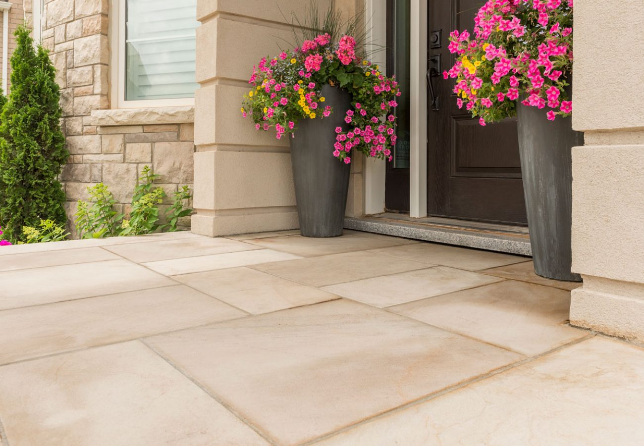 Unilock entrance with Natural Stone flagstone pavers