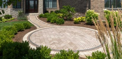 Unilock entrance and walkway with Mattoni antiqued pavers
