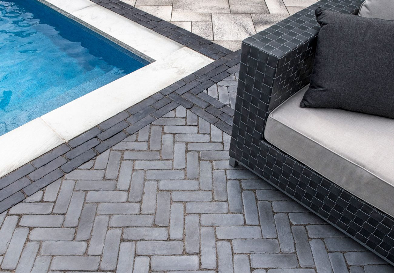 Contemporary Unilock pool deck with Umbriano EnduraColor and Copthorne Elegance pavers