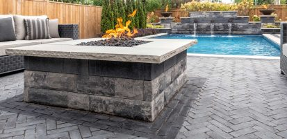 Contemporary Unilock U-Cara fire and water features with Copthorne Elegance paver pool deck and patio