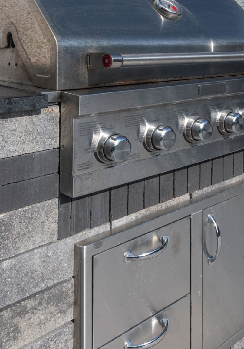 Closeup of Unilock Lineo Dimensional Stone outdoor kitchen
