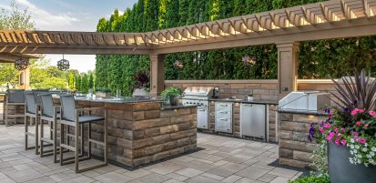 Unilock U-Cara outdoor kitchen and Beacon Hill Smooth EnduraColor patio