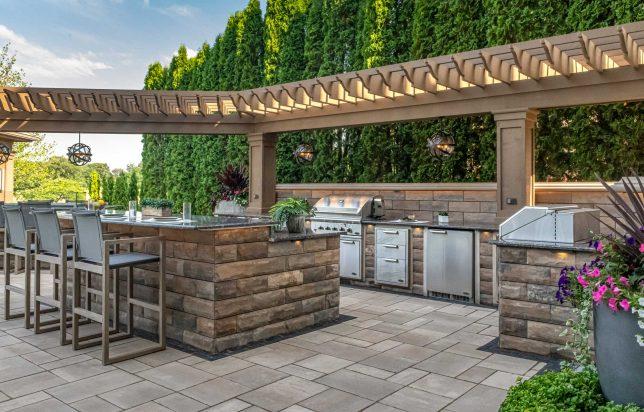 Unilock U-Cara outdoor kitchen and Beacon Hill Smooth EnduraColor patio