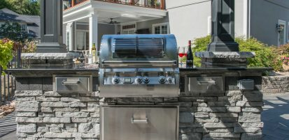 Outdoor Kitchen and pillar built with Unilock Rivercrest Wall