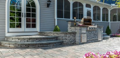 Outdoor kitchen, entrance and surrounding patio using Unilock Rivercrest Wall and Richcliff Elegance pavers