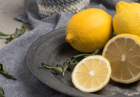 Closeup of lemons on a slate grey plate