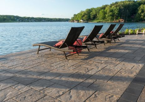 Unilock Outdoor living space with Beacon Hill Flagstone paver patio
