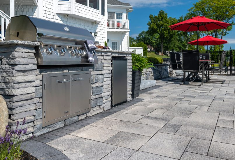 Unilock Umbriano paver patio with Rivercrest Wall outdoor kitchen