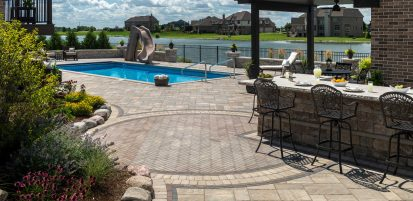 Patio and pool deck made with Unilock antiqued Mattoni and Brussels Premier, and Beacon Hill Smooth pavers