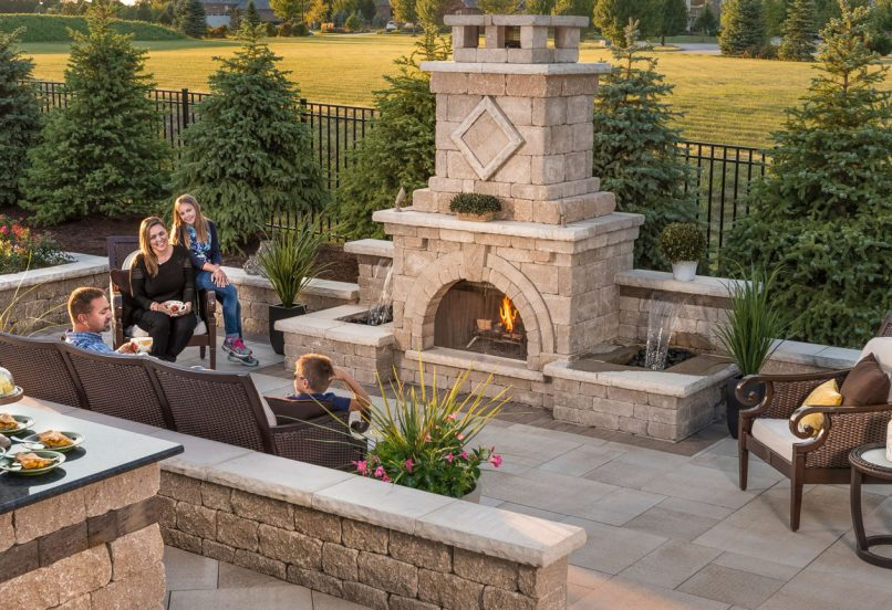 Unilock Outdoor living with Estate Wall fireplace and seat wall, and Umbriano pool deck