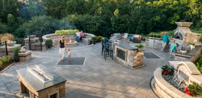 Unilock Outdoor living space with Bristol Valley pavers, Olde Quarry water and fire features and outdoor kitchen