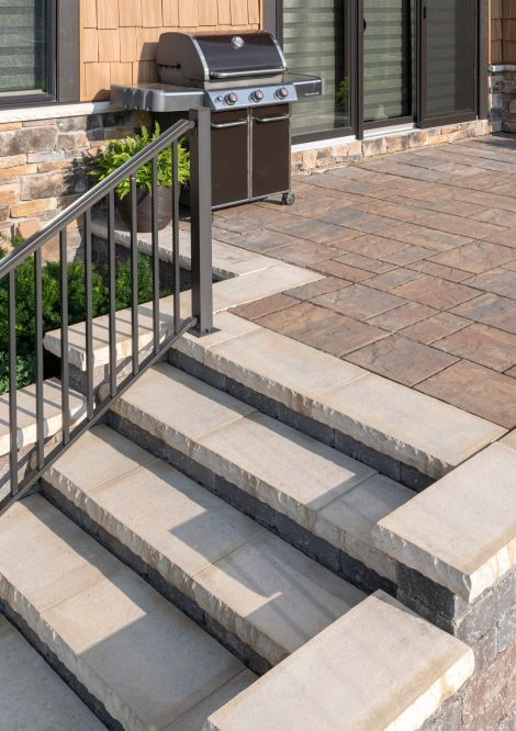 Unilock Beacon Hill Flagstone EnduraColor paver patio with Ledgestone steps