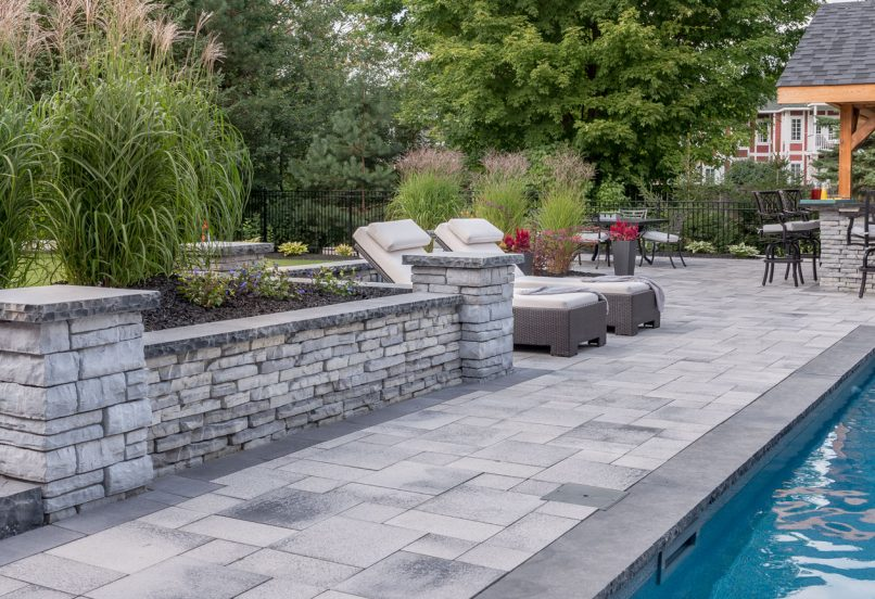 Unilock Umbriano pool deck and Rivercrest Wall