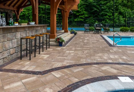 Unilock Bristol Valley paver pool deck with Copthorne Elegance paver accents