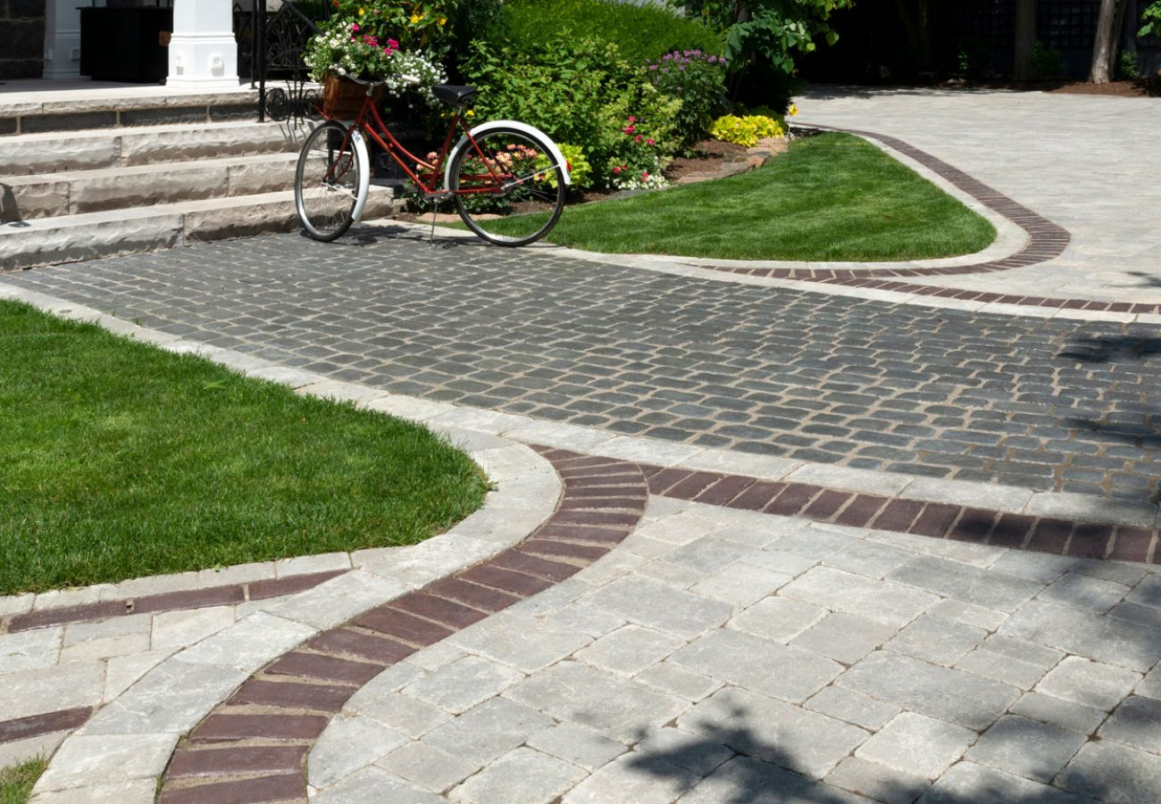 Unilock Courtstone heritage cobblestone walkway and entrance with antiqued Brussels Block driveway
