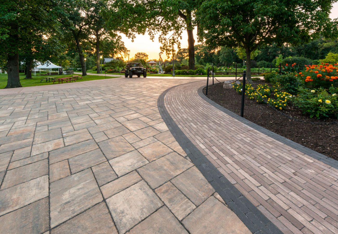 Unilock antiqued Mattoni walkway and Windermere driveway in a park-like setting