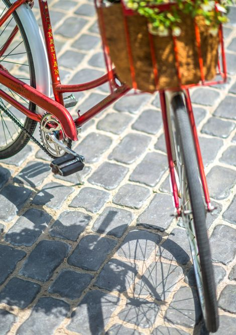 Close up of vintage bicycle parked on Unilock Courstone heritage cobblestone pavers