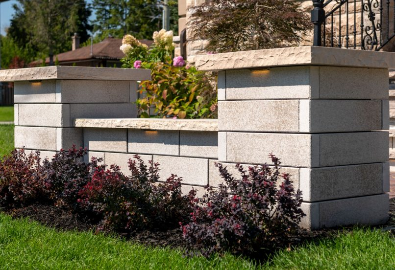 Contemporary Unilock U-Cara wall and pillars with Ledgestone caps