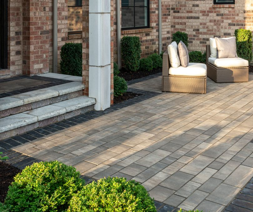Unilock entryway with EnduraColor Artline linear plank pavers and Town Hall accents