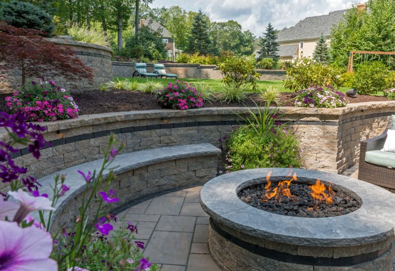 Estate Wall seat wall and fire feature, surrounded by Beacon Hill Flagstone pavers