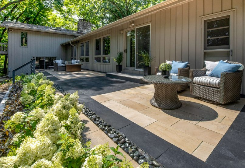Contemporary Unilock outdoor living space with Natural Stone patio