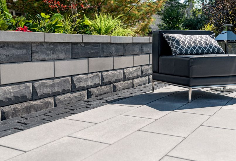Contemporary outdoor living space with Unilock EnduraColor Umbriano pavers and U-Cara seat wall