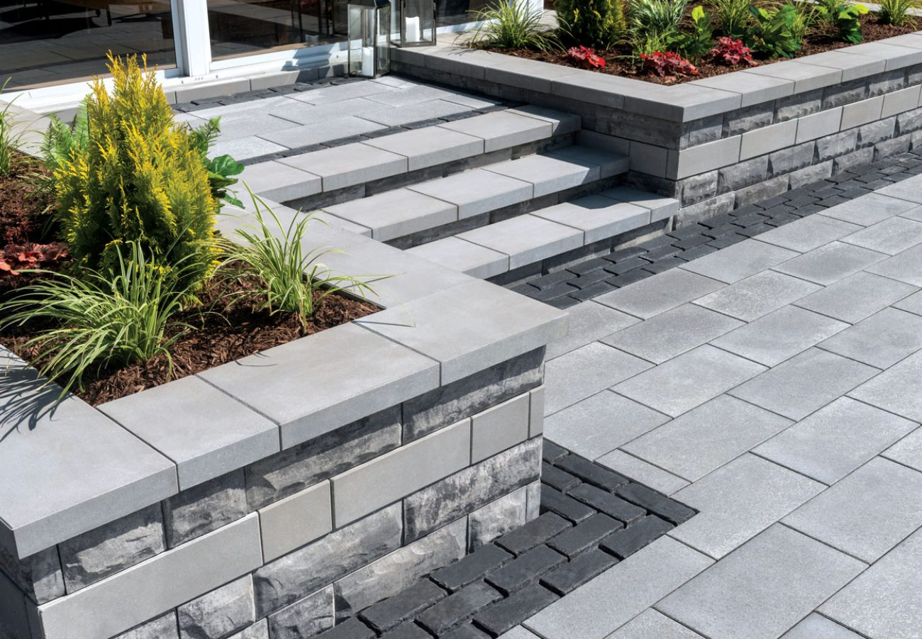 Contemporary entrance with Unilock Umbriano pavers and U-Cara garden walls and steps in Universal Coping