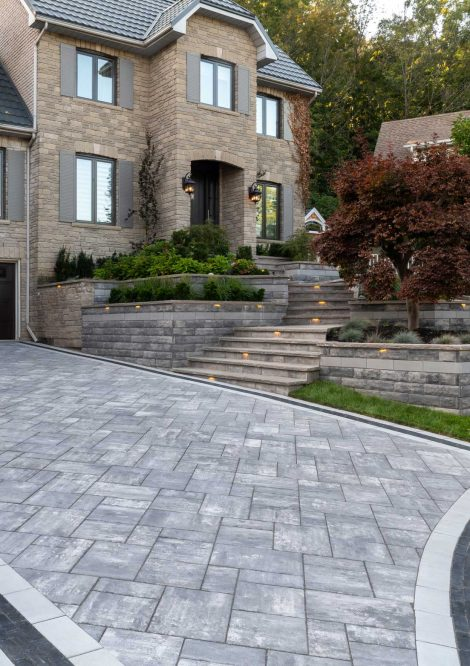 Contemporary Unilock Beacon Hill Smooth driveway with U-Cara retaining walls and entryway