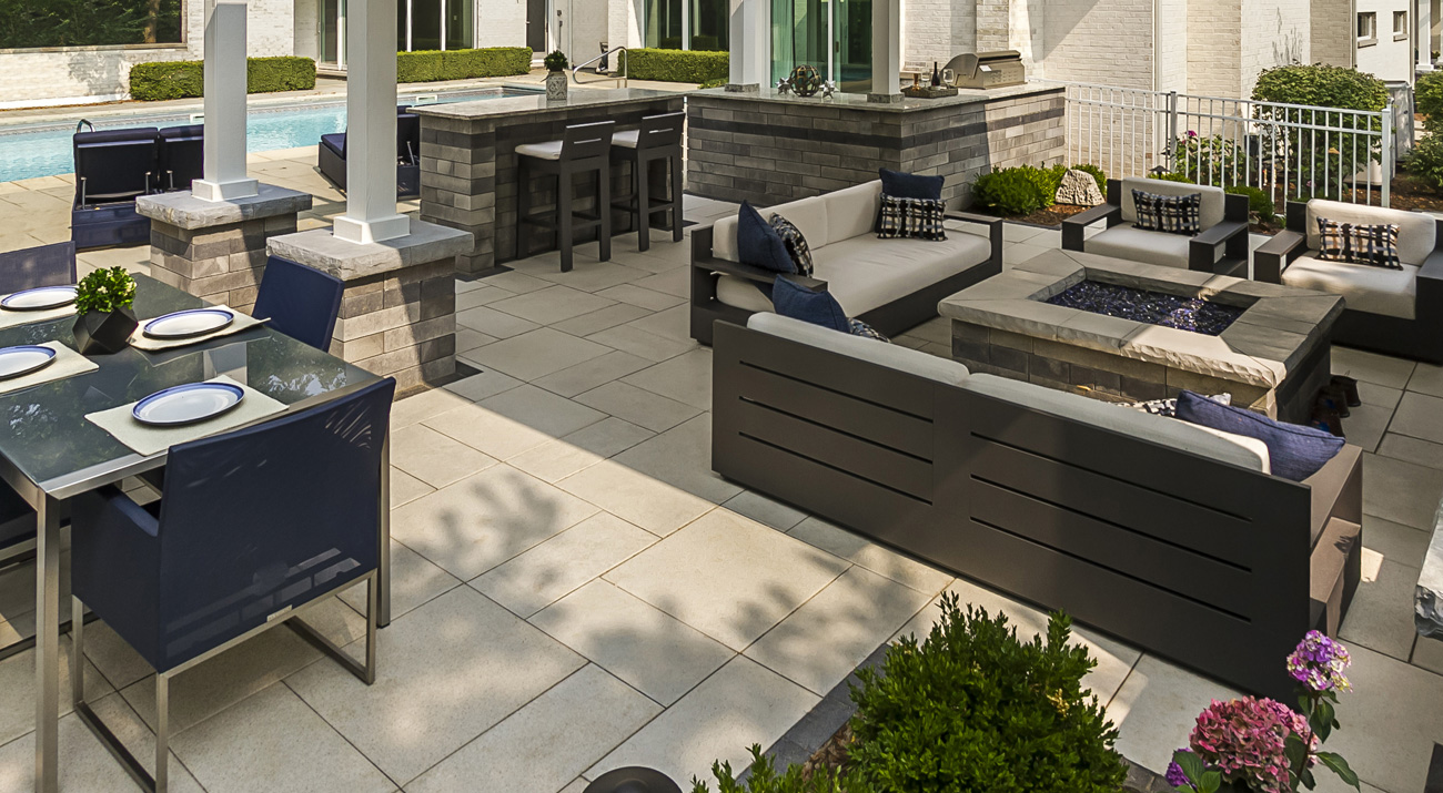 Unilock Arcana contemporary paver outdoor living space and outdoor kitchen patio