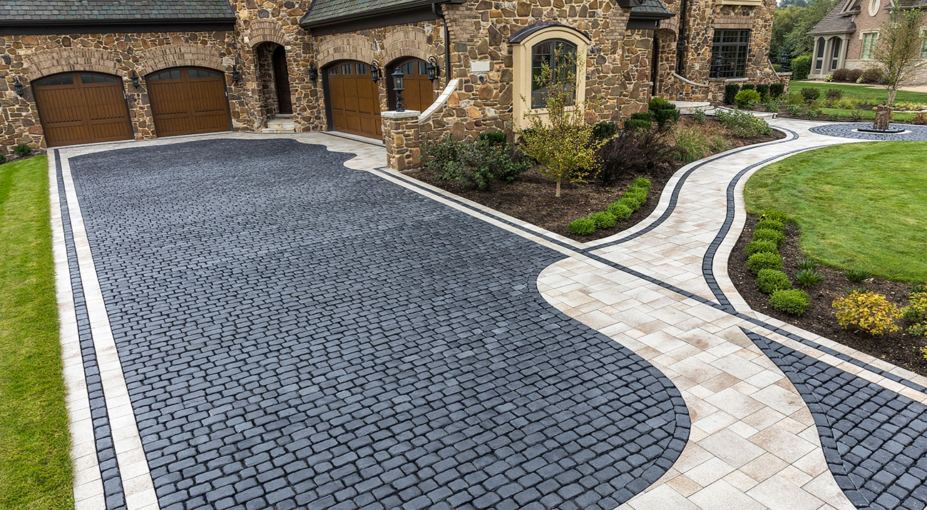 Unilock Courtstone Elegance heritage paver driveway with contemporary walkway