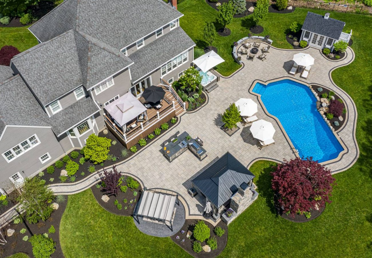 Outdoor Living retreat with outdoor kitchen and pool deck shot from above